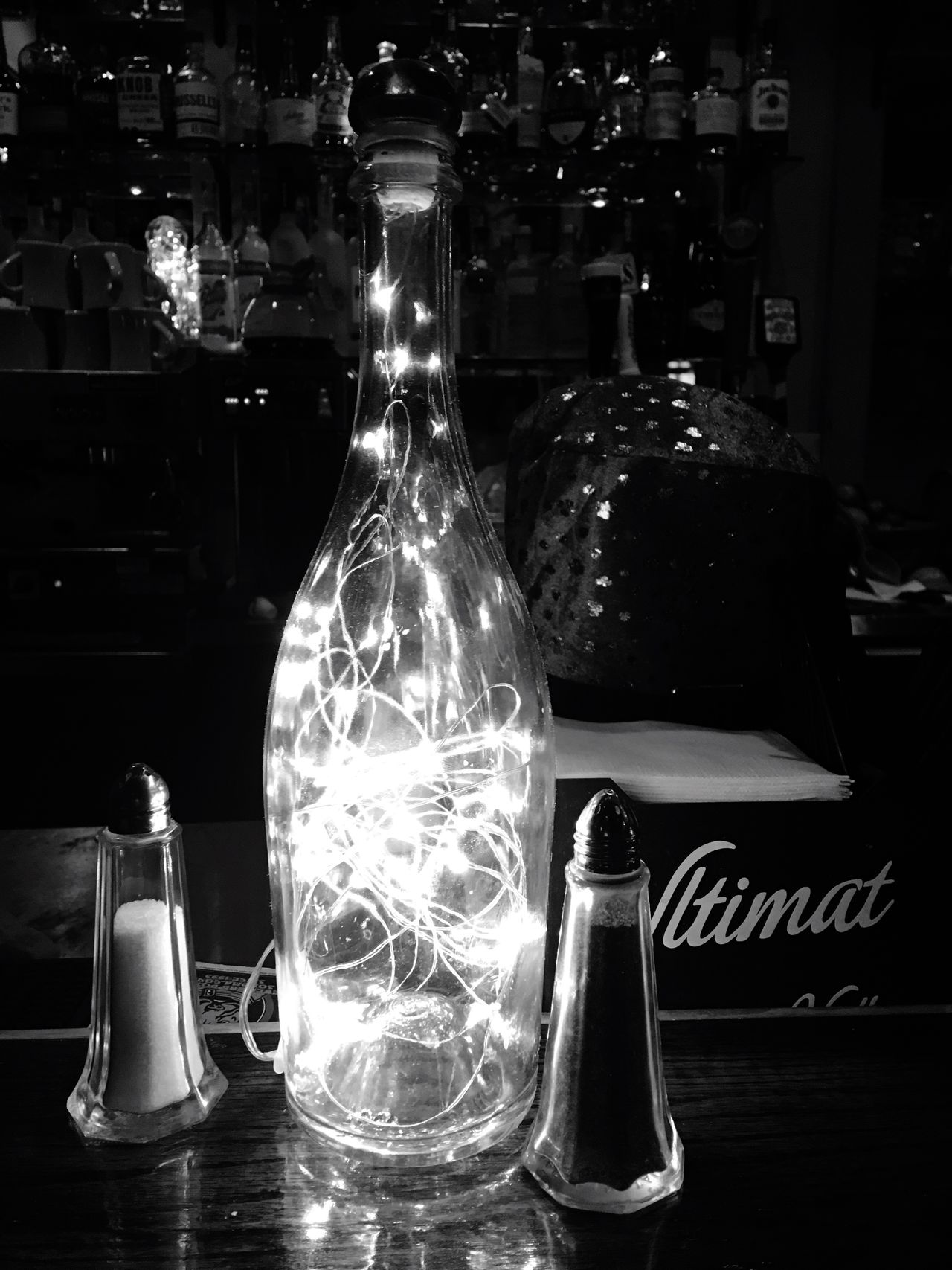 Bottle Indoors  Lights And Shadows Darkness And Light Bar Alcohol Salt And Pepper Shakers Salt And Pepper No People Close-up Day String Of Lights String Of Lights In A Bottle
