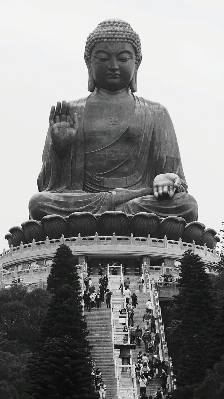 Low Angle View Of Statue Of Big Buddha Against Clear Sky