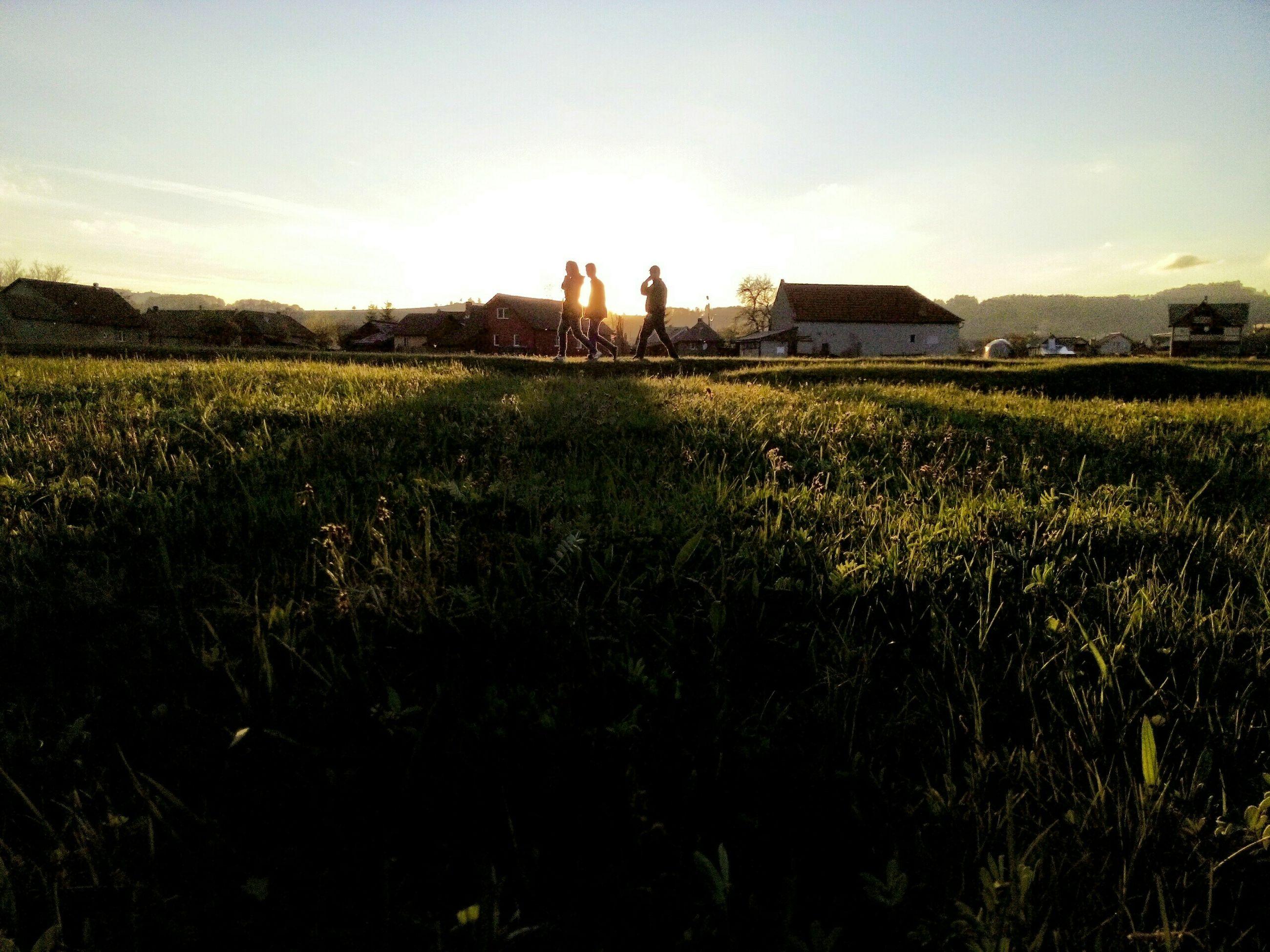 grass, field, sky, sunset, men, lifestyles, grassy, leisure activity, landscape, building exterior, nature, growth, built structure, plant, architecture, rural scene, sunlight, person