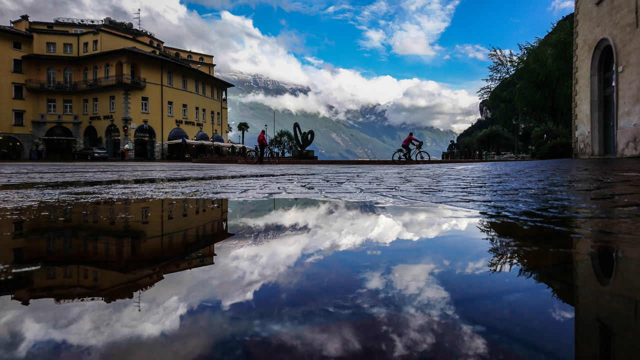 Biker Alto Adige Architecture Bike Building Exterior Cloud - Sky Day EyeEm Best Shots Gardasee Lago Di Garda Men Mountain Outdoors People Puddle Puddleography Real People Reflection Sky The Alps Water Women