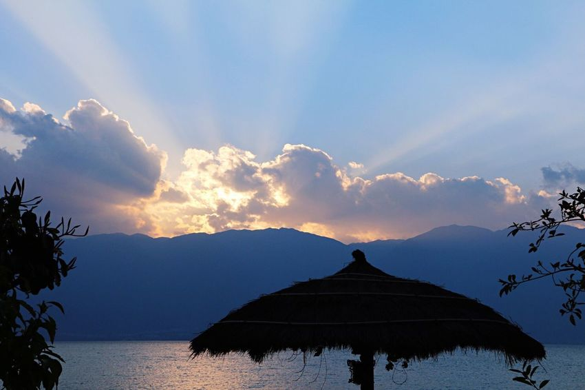 Scenics Thatched Roof Sky Beauty In Nature Nature Mountain Tranquility Cloud - Sky No People Outdoors Silhouette Tranquil Scene Architecture Sunset Built Structure Building Exterior Water Day Lost In The Landscape Connected By Travel EyeEmNewHere