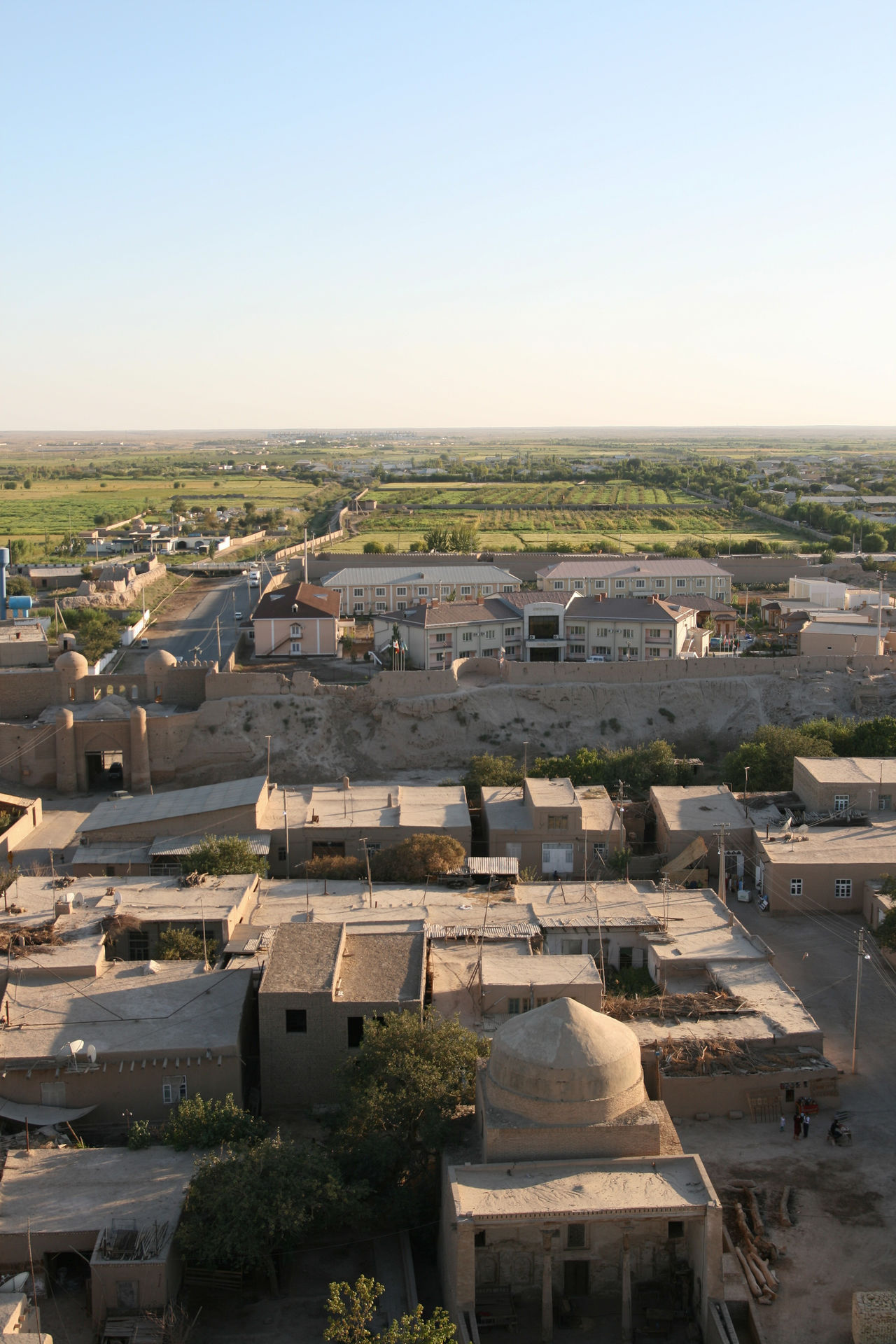 Architecture Building Exterior Built Structure Clear Sky Community Culture Damaged Day Defensive Wall Dome Fields High Angle View House Human Settlement Islamic Architecture Khiva Log Old Outer Wall Perspective Residential District Roof Silk Road Uzbekistan