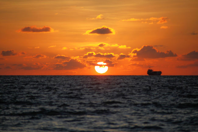 Silhouette of freight ship at sunrise over Atlantic Ocean in Miami Beach, Florida Atlantic Ocean Beauty In Nature Early Freight Transportation Horizon Over Water Horizontal Industry Morning Nature Orange Outdoors Sea Ship Silhouette Sky Sun Sunrise Traffic Transportation Water