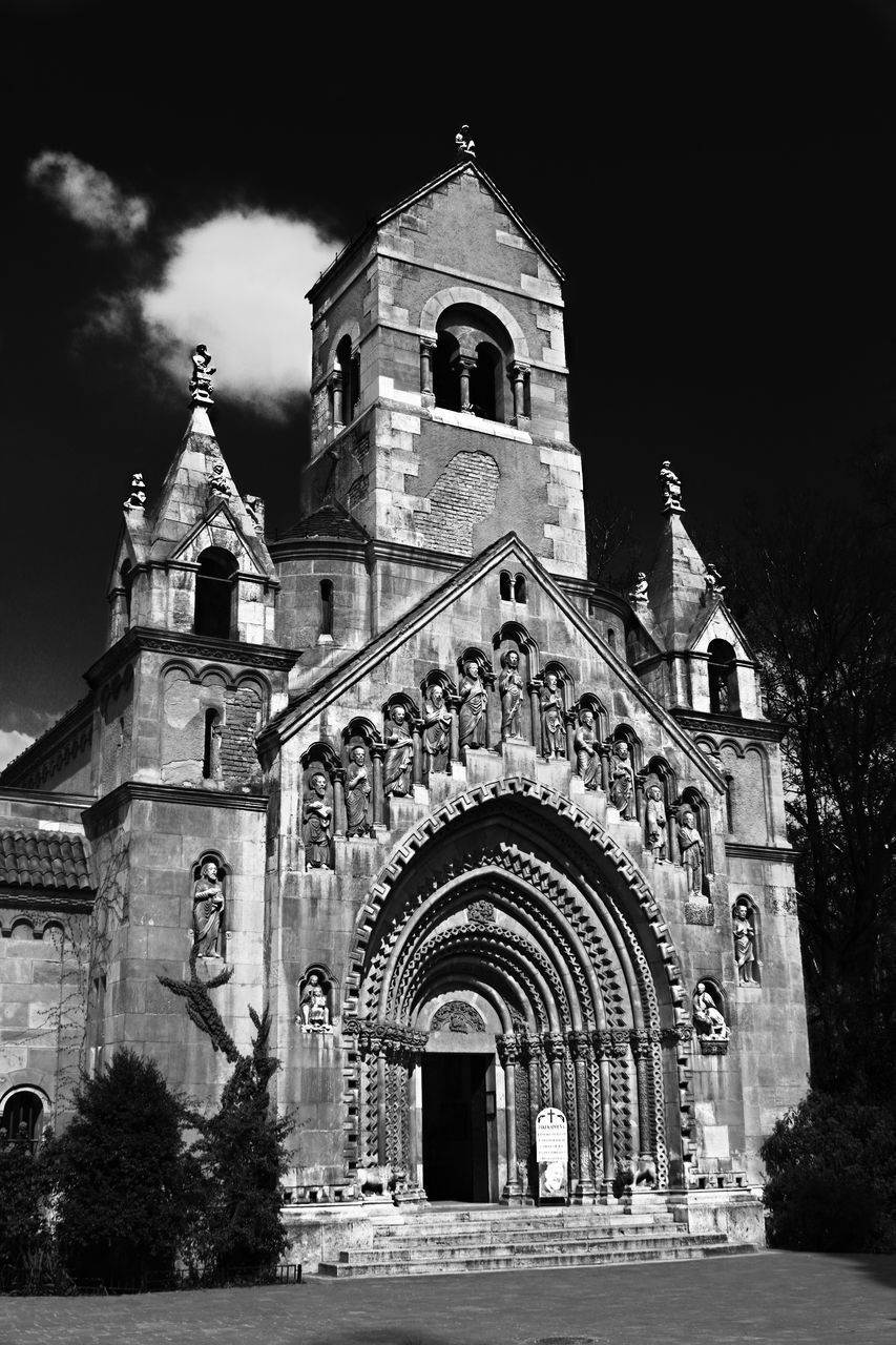 religion, place of worship, spirituality, architecture, built structure, building exterior, arch, facade, low angle view, history, outdoors, sky, travel destinations, no people, day, bell tower, sculpture