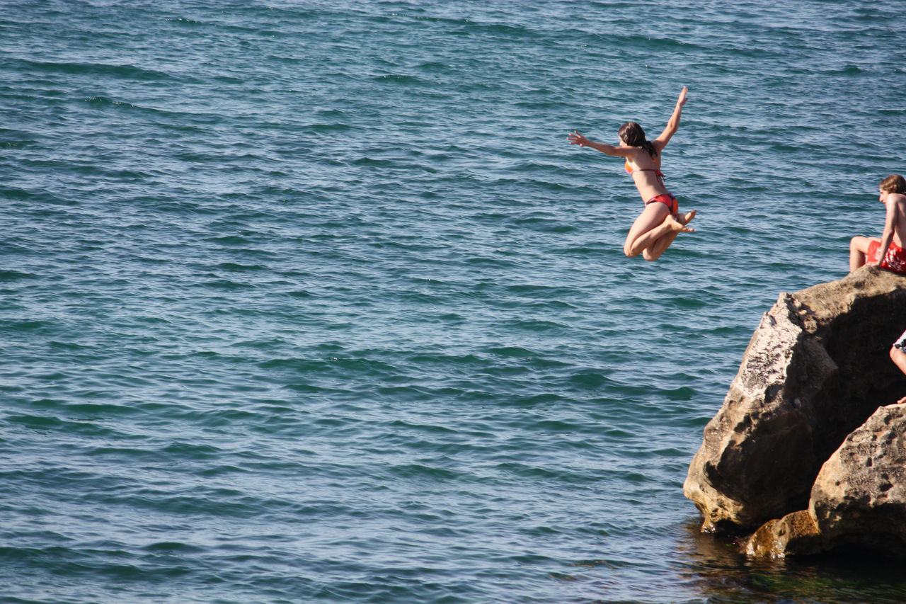 Beautiful stock photos of jump, Arms Outstretched, Beauty In Nature, Cliff, Day