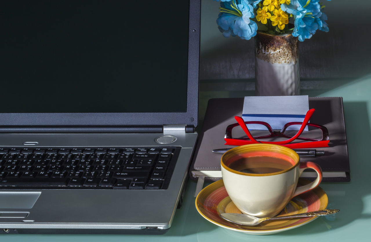 Laptop with coffee cup on office table Background Business Finance And Industry Caffeine Coffee - Drink Coffee Cup Computer Computer Keyboard Connection Creativity Internet Keyboard Laptop Message Morning NotePad Office Technology Wireless Technology Work Workspace