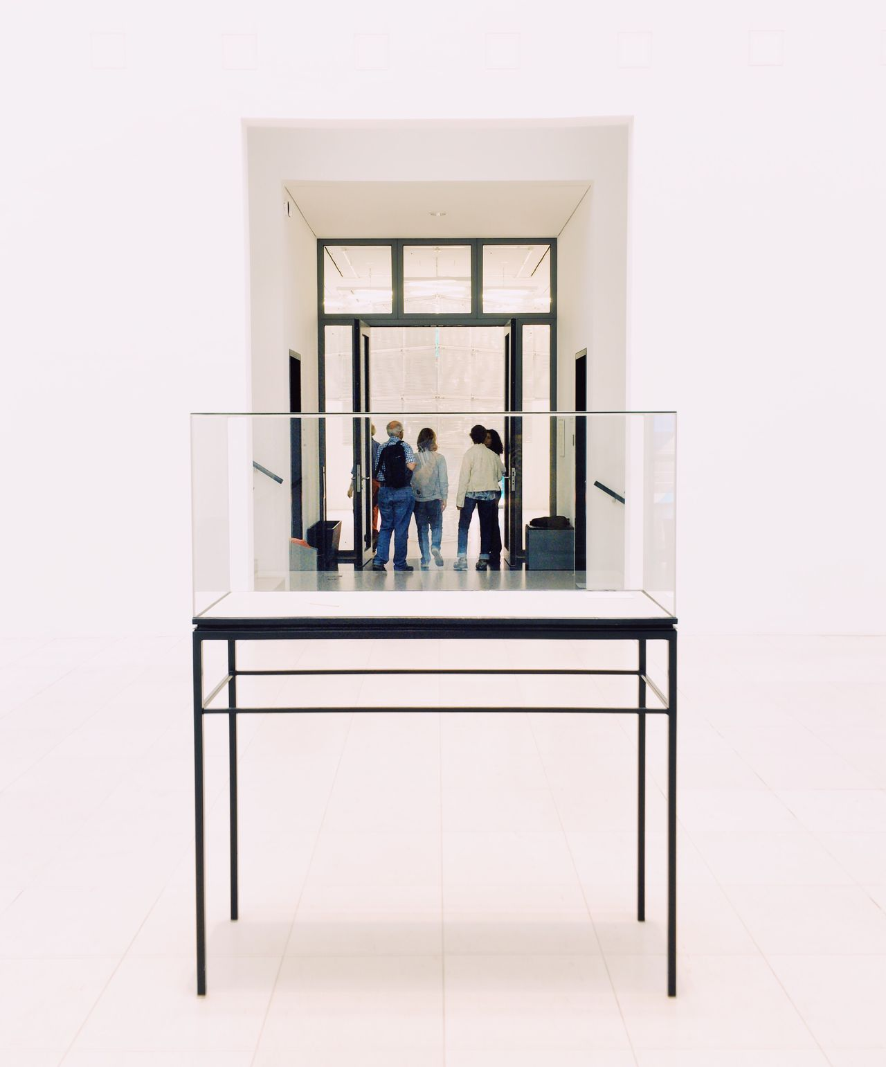 People in a Display Case. Series. Modern indoors full length Architecture people Teamwork Urban geometry Minimalist Architecture interior design art ArtWork arts culture and entertainment museum minimalism minimal Architecture architectural feature Better Look Twice conceptual conceptual photography Mobile Conversations