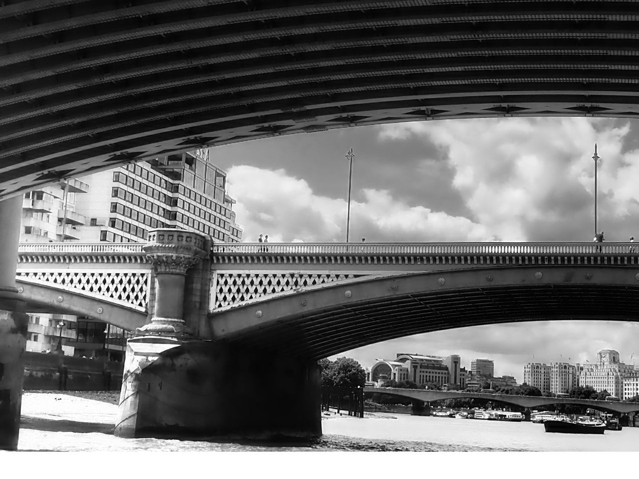 architecture, bridge - man made structure, connection, built structure, cloud - sky, sky, river, water, transportation, day, arch, building exterior, bridge, city, outdoors, modern, no people, cityscape, under