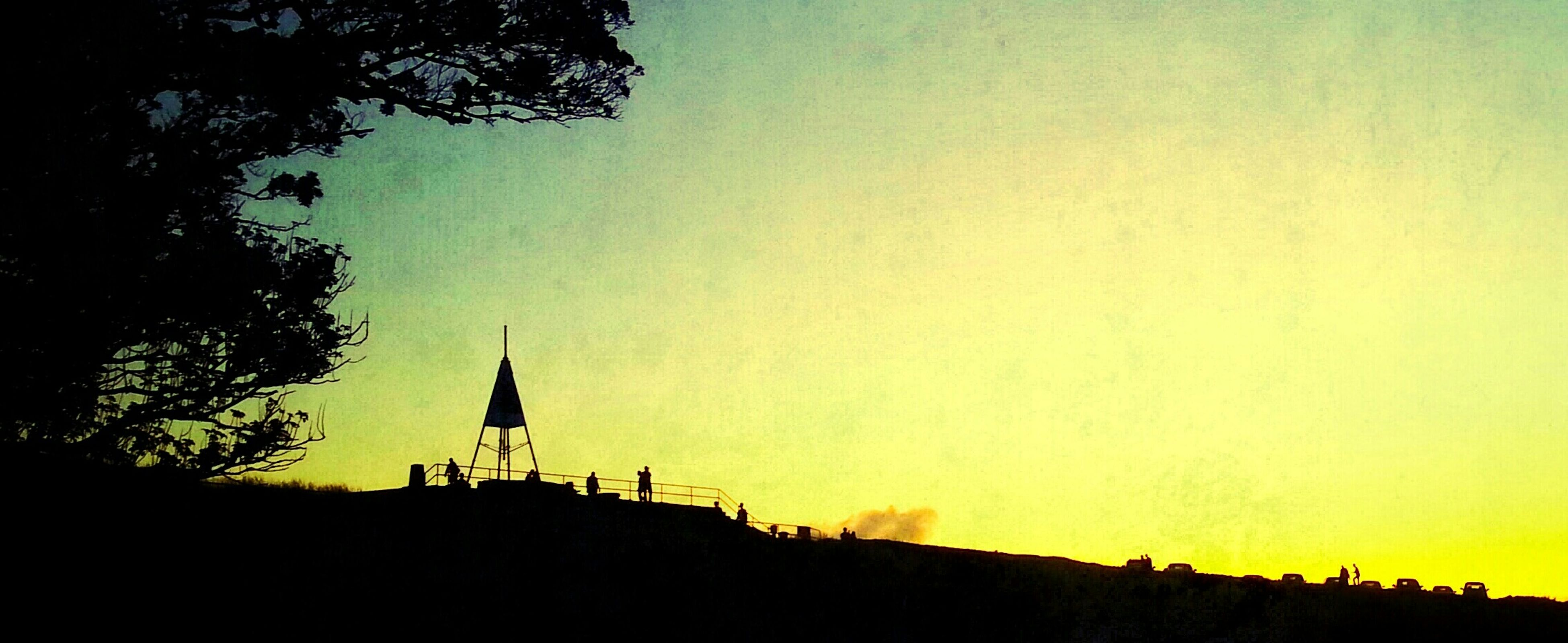 silhouette, sunset, copy space, clear sky, tree, built structure, building exterior, architecture, orange color, beauty in nature, nature, scenics, tranquility, dusk, sky, tranquil scene, low angle view, outdoors, landscape, no people