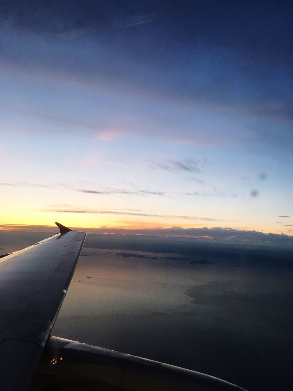sunset, airplane, transportation, journey, travel, sky, airplane wing, air vehicle, nature, mode of transport, aerial view, cloud - sky, beauty in nature, scenics, no people, aircraft wing, tranquil scene, flying, outdoors, close-up, day