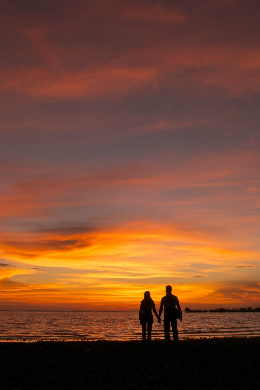 sunset, silhouette, sea, orange color, sky, beauty in nature, togetherness, nature, scenics, horizon over water, real people, beach, leisure activity, water, cloud - sky, men, two people, lifestyles, outdoors, friendship, vacations, people