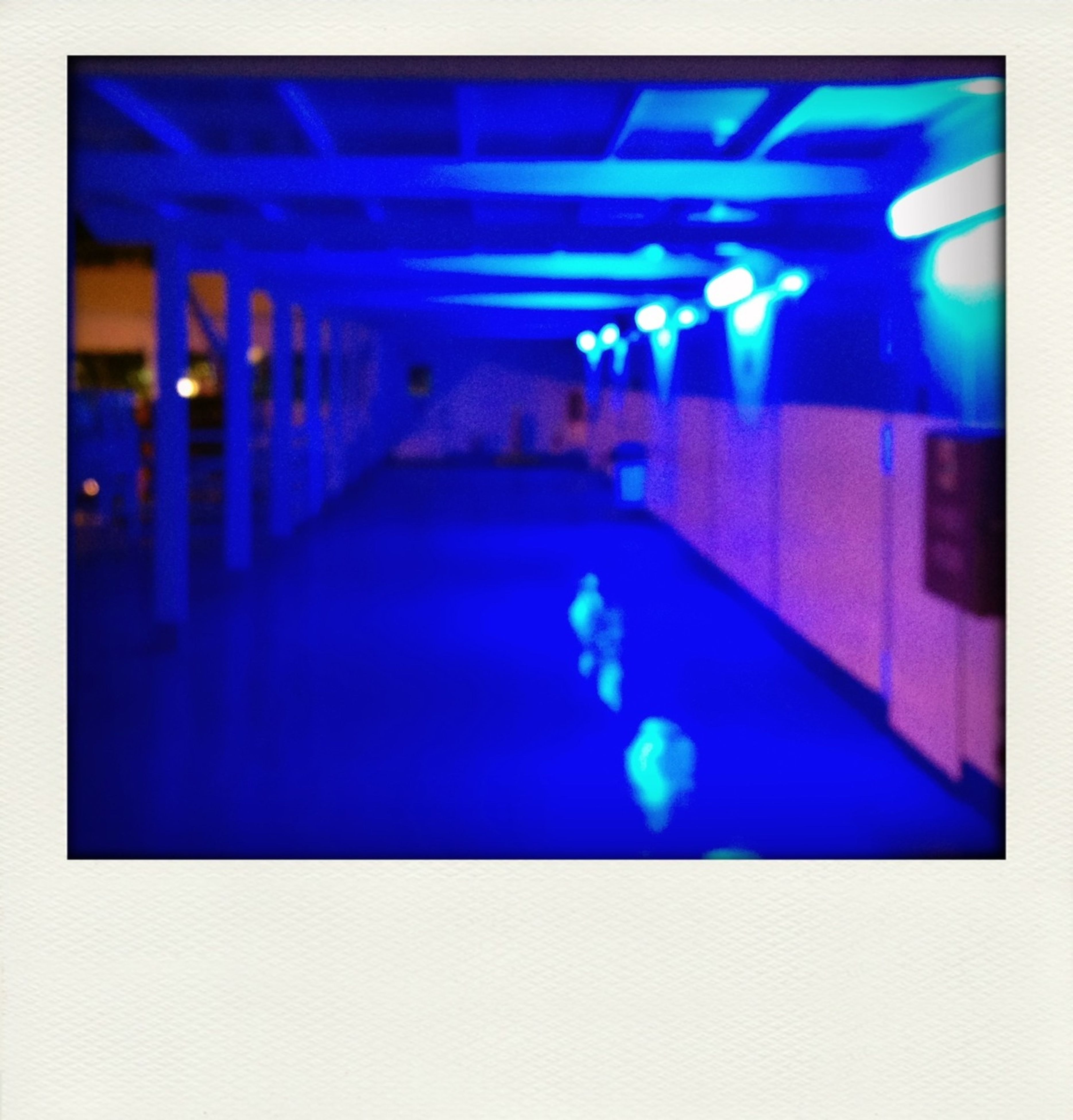 illuminated, transfer print, blue, night, indoors, lighting equipment, auto post production filter, light - natural phenomenon, glowing, nightlife, defocused, electric light, light, light beam, nightclub, multi colored, abstract, technology, close-up, electricity