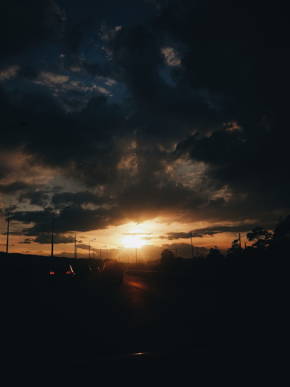 sunset, cloud - sky, sky, silhouette, car, transportation, no people, beauty in nature, nature, scenics, dramatic sky, tranquil scene, tranquility, mode of transport, land vehicle, sun, tree, outdoors, road, storm cloud, day