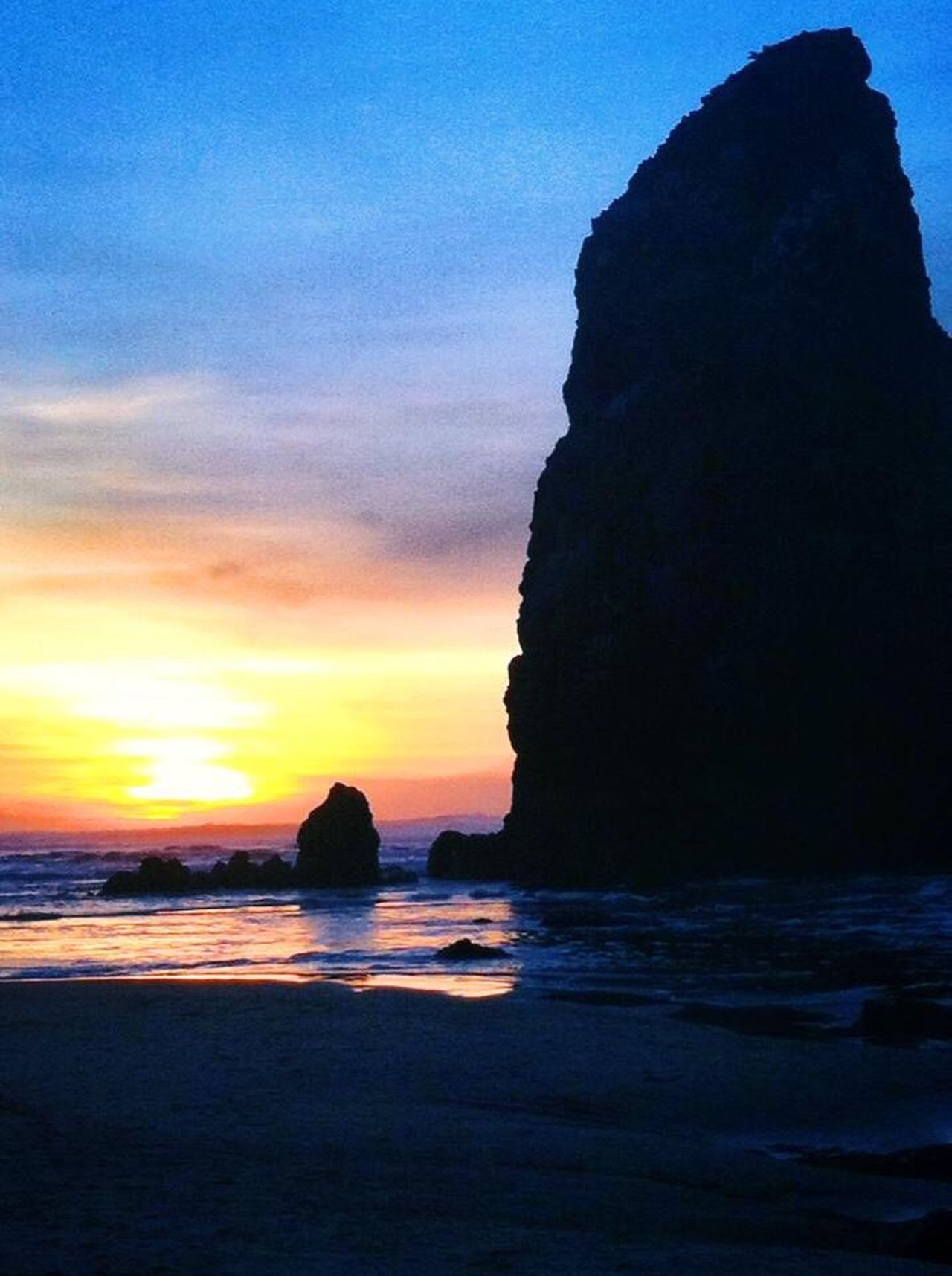 Sea Beauty In Nature Sunset Nature Scenics Rock - Object Rock Formation Horizon Over Water Tranquil Scene Sky Tranquility Cannon Beach Idyllic Travel Destinations No People Cliff Silhouette Beach Outdoors Day Awesome_shots Awesome Ocean Beautiful Beach Beautiful Beaches Best Sunrises And Sunsets