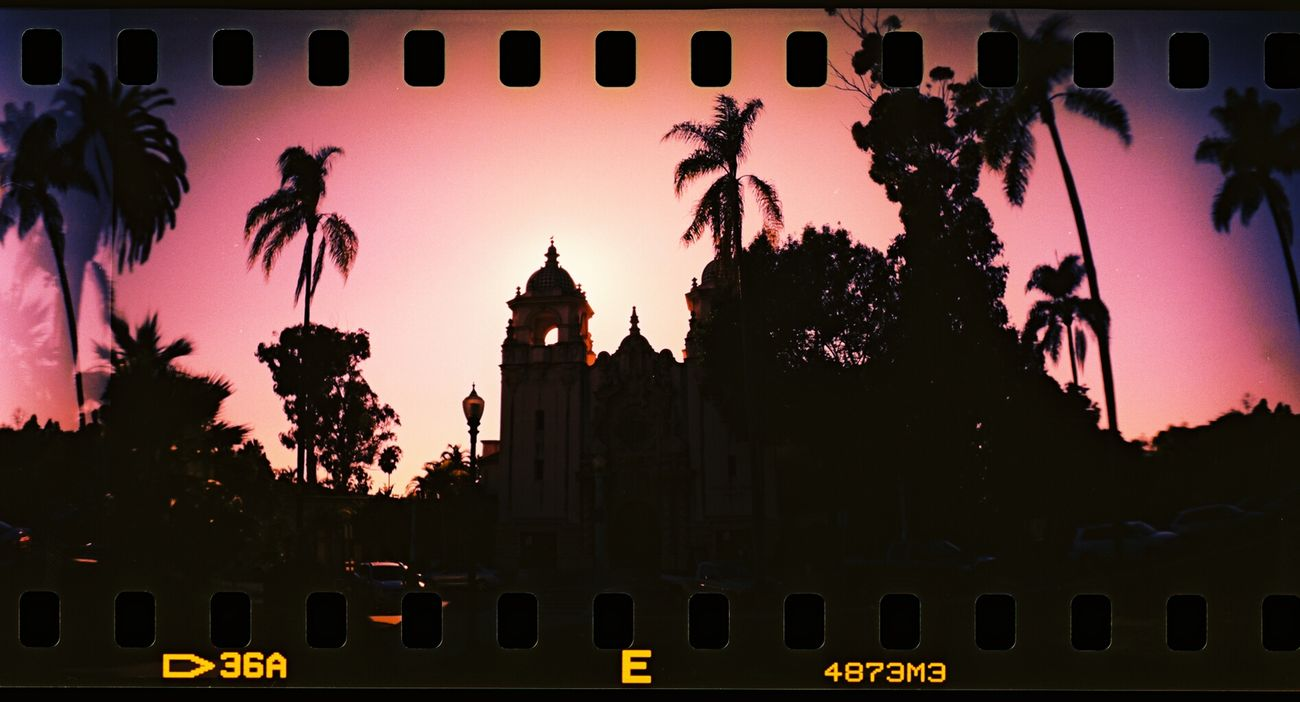 GetYourGuide Cityscapes San Diego Sunset Sprocket Rocket Panorama Lomography silhouette of a cathedral shot in balboa park, San Diego, California.