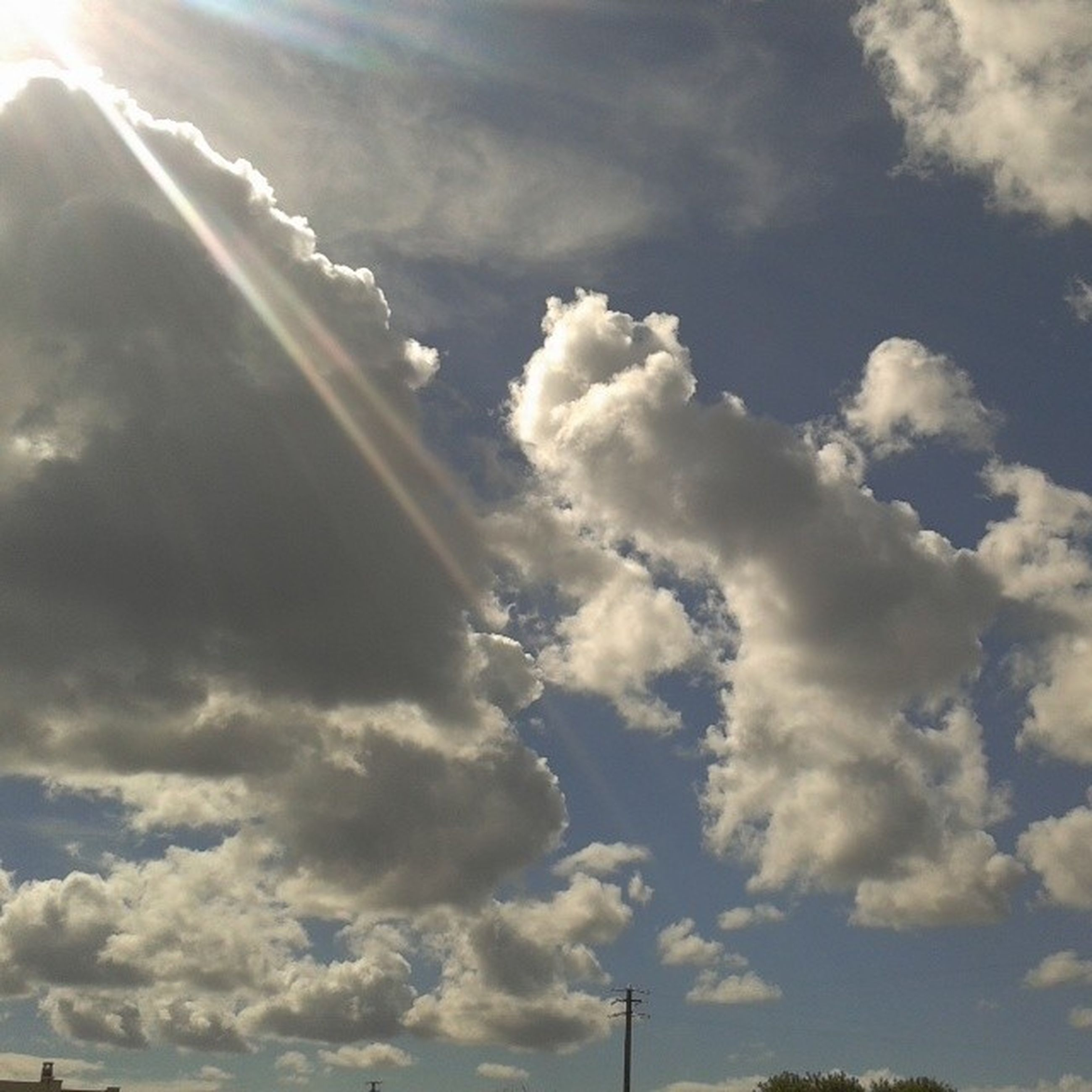 sky, cloud - sky, low angle view, cloudy, beauty in nature, scenics, nature, cloud, cloudscape, tranquility, tranquil scene, sunbeam, sunlight, outdoors, sun, day, weather, no people, sky only, idyllic