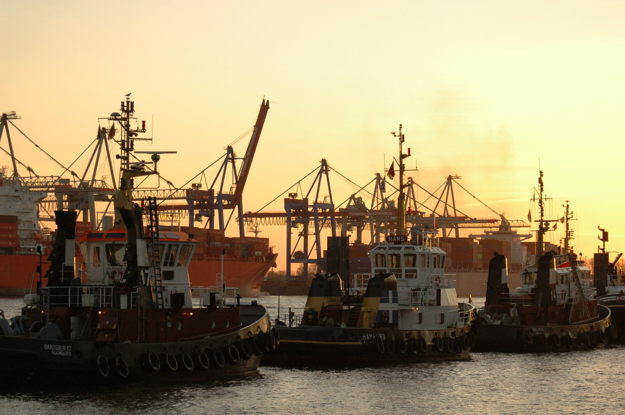 nautical vessel, freight transportation, transportation, industry, commercial dock, shipping, crane - construction machinery, harbor, mode of transport, outdoors, no people, waterfront, water, building exterior, built structure, cargo container, architecture, day, sea, clear sky, sky, city, nature, shipyard
