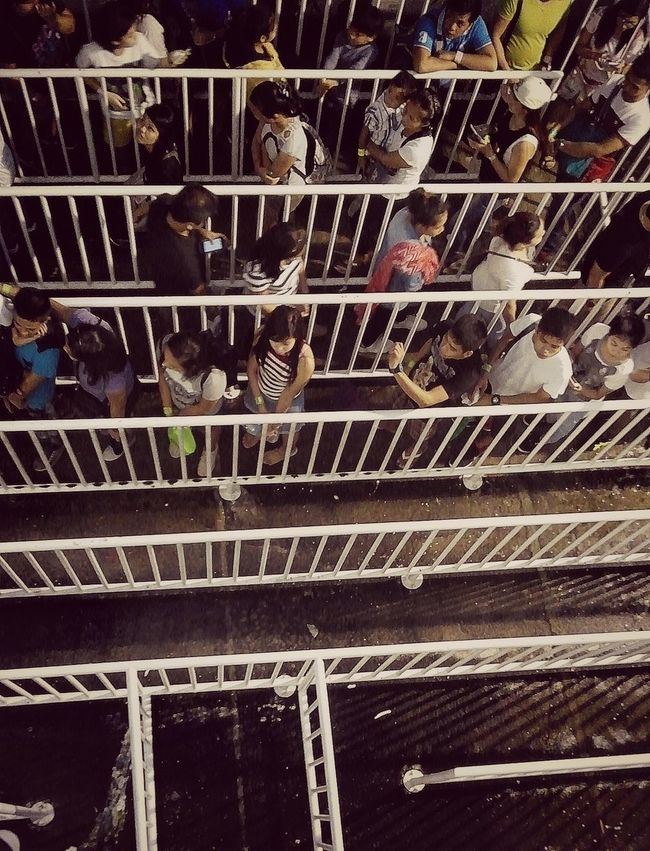 Eyeem Philippines Half Full, Half Empty LINE Men Messy Opposite Directions People Are People People Around You Peoplephotography Shadows & Lights Top View Waiting For The Rain Waiting In Line White Gate Women