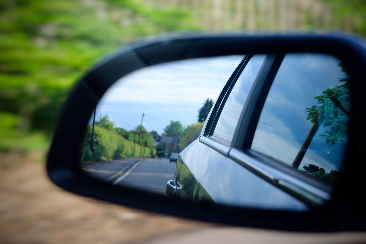 Helios 44-2 Side-view Mirror Car Reflection Mirror Land Vehicle Transportation Mode Of Transport Window Vehicle Mirror No People Day Road Road Trip Tree Close-up Nature Outdoors Sky Selective Focus Movement Blur Blurred Motion Fast