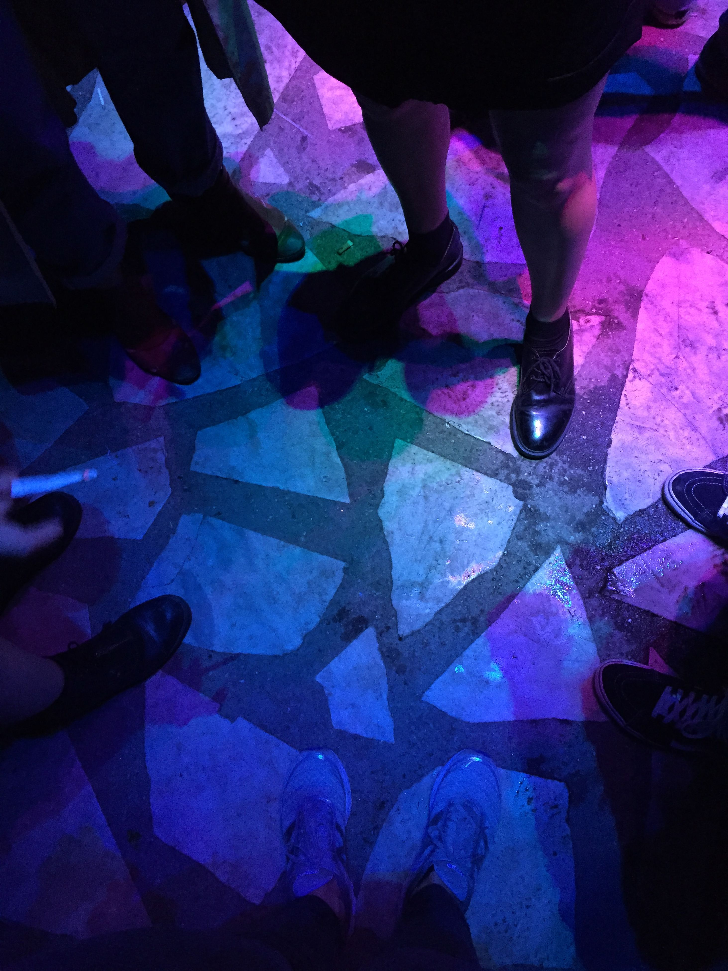 indoors, low section, lifestyles, men, person, high angle view, unrecognizable person, leisure activity, purple, night, togetherness, standing, part of, close-up
