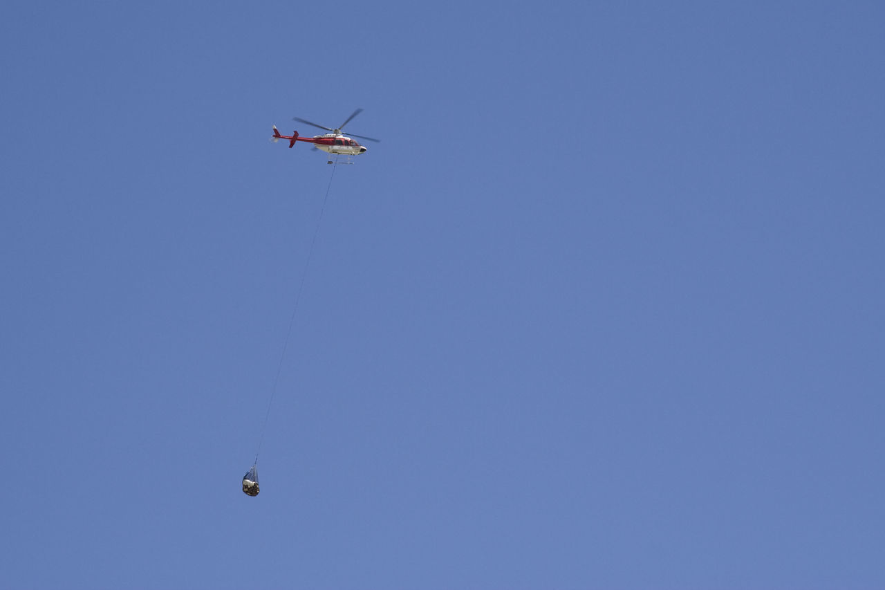helicopter carrying cargo - canadian rockies, banff national park Air Vehicle Aircraft Ambulance Blue Sky Canada Cargo Chopper Clear Sky Container Emergency Flight Flying Freight Transportation Helicopter Helicopter Help Hovering Low Angle View Mid-air No People Outdoors Rescue Sos Transportation Urgency