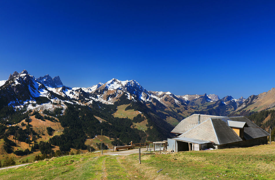 Canon Architecture Beauty In Nature Blue Chalet Clear Sky Day Grass Green Color Landscape Mountain Mountain Range Nature No People Outdoors Rural Scene Scenics Sky Snow Swiss Switzerland Tranquil Scene Tranquility Travel Travel Destinations