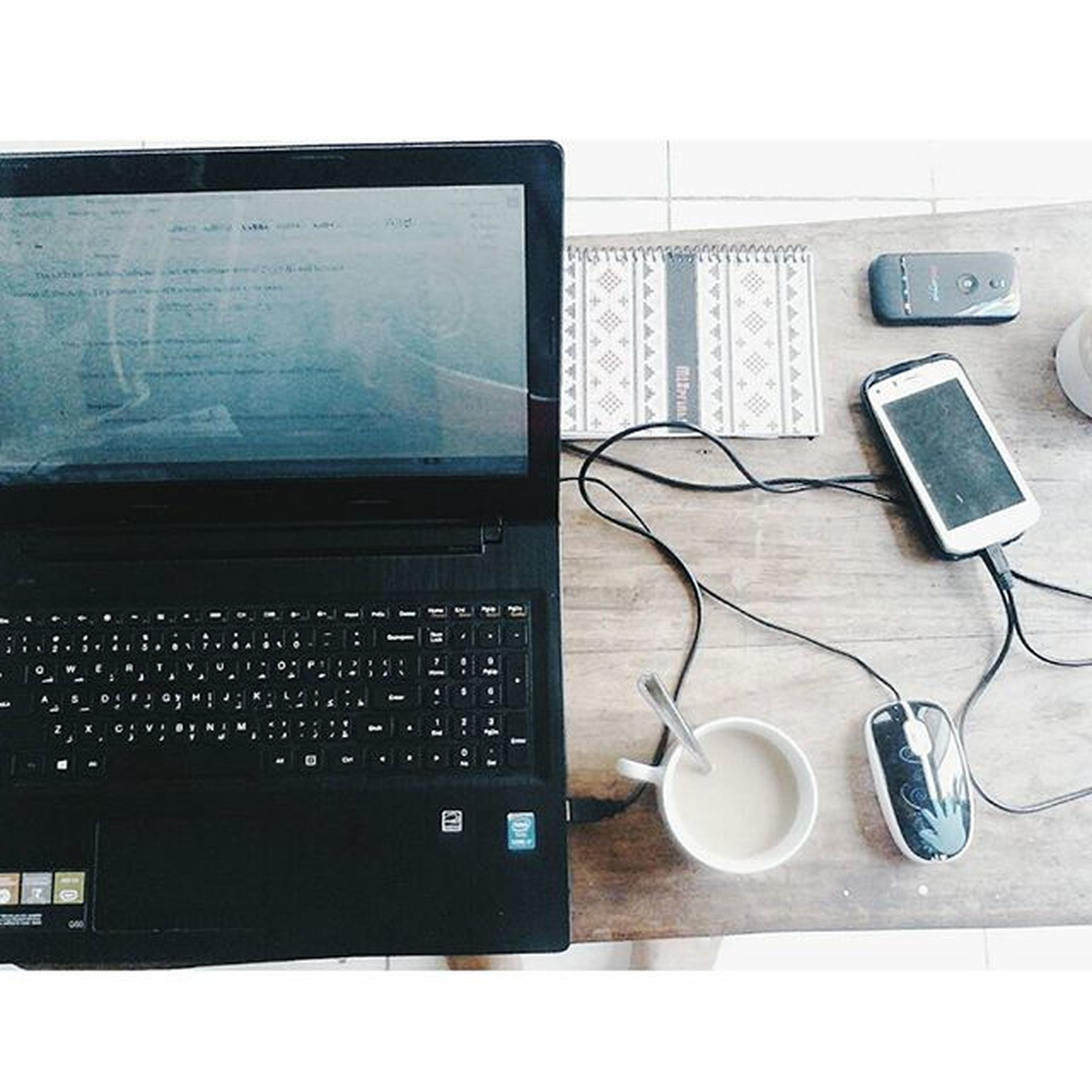 indoors, table, technology, communication, still life, connection, book, wireless technology, computer, laptop, close-up, desk, paper, absence, education, pen, equipment, chair, music, high angle view