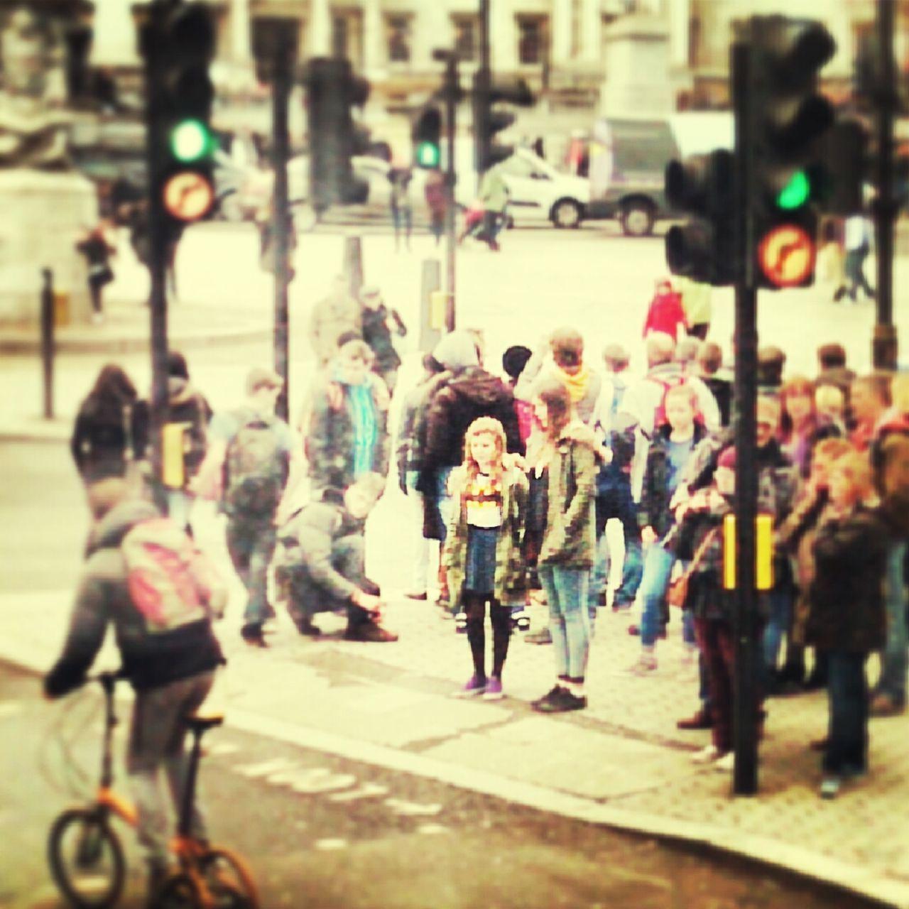 Group Of People On City Sidewalk