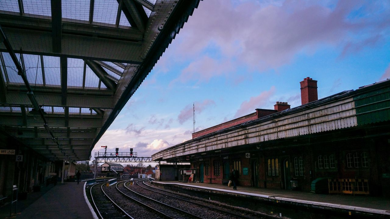 An Evening at Shrewsbury Station Sky Bridge - Man Made Structure Cloud - Sky Transportation Built Structure Tree City Connection Architecture Outdoors No People Day Twilight Commuting Rails Railway Railroad Track Sunset Winter Platform British Britain