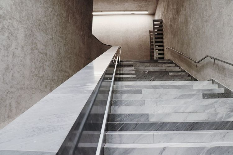 A staircase in Kunstmuseum Basel. A very cold atmosphere strongly contrasts to the art that is displayed inside the exhibition rooms. Staircase Staircases Staircase Perspective Stairs_collection Museum Basel Basel, Switzerland Kunstmuseumbasel Cold Atmosphere Architecture_collection Architecture Details Marble The Graphic City