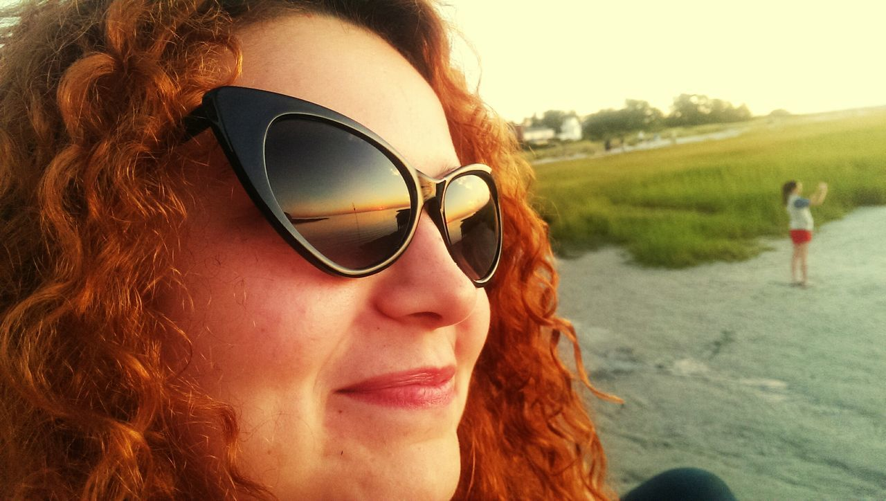 sunglasses, redhead, real people, young women, young adult, outdoors, one person, day