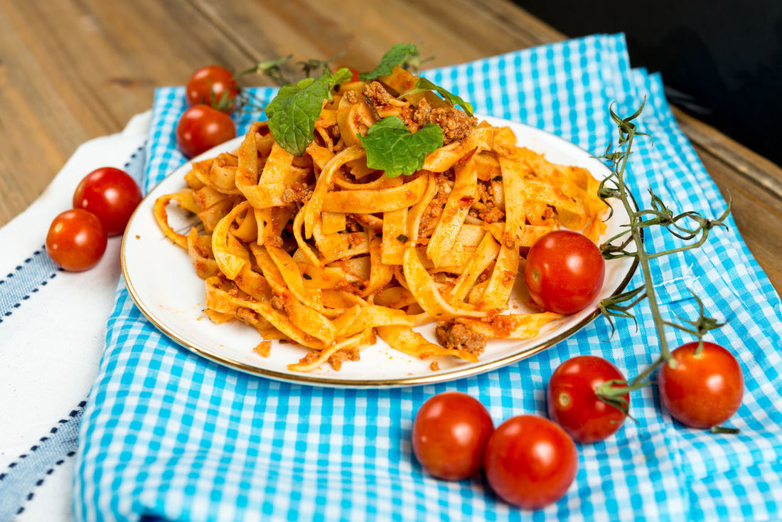Close-up Day Food Food And Drink Freshness Indoors  Meat Meat Sauce No People Pasta Plate Ready-to-eat Red Table Tagliatelle Tomato