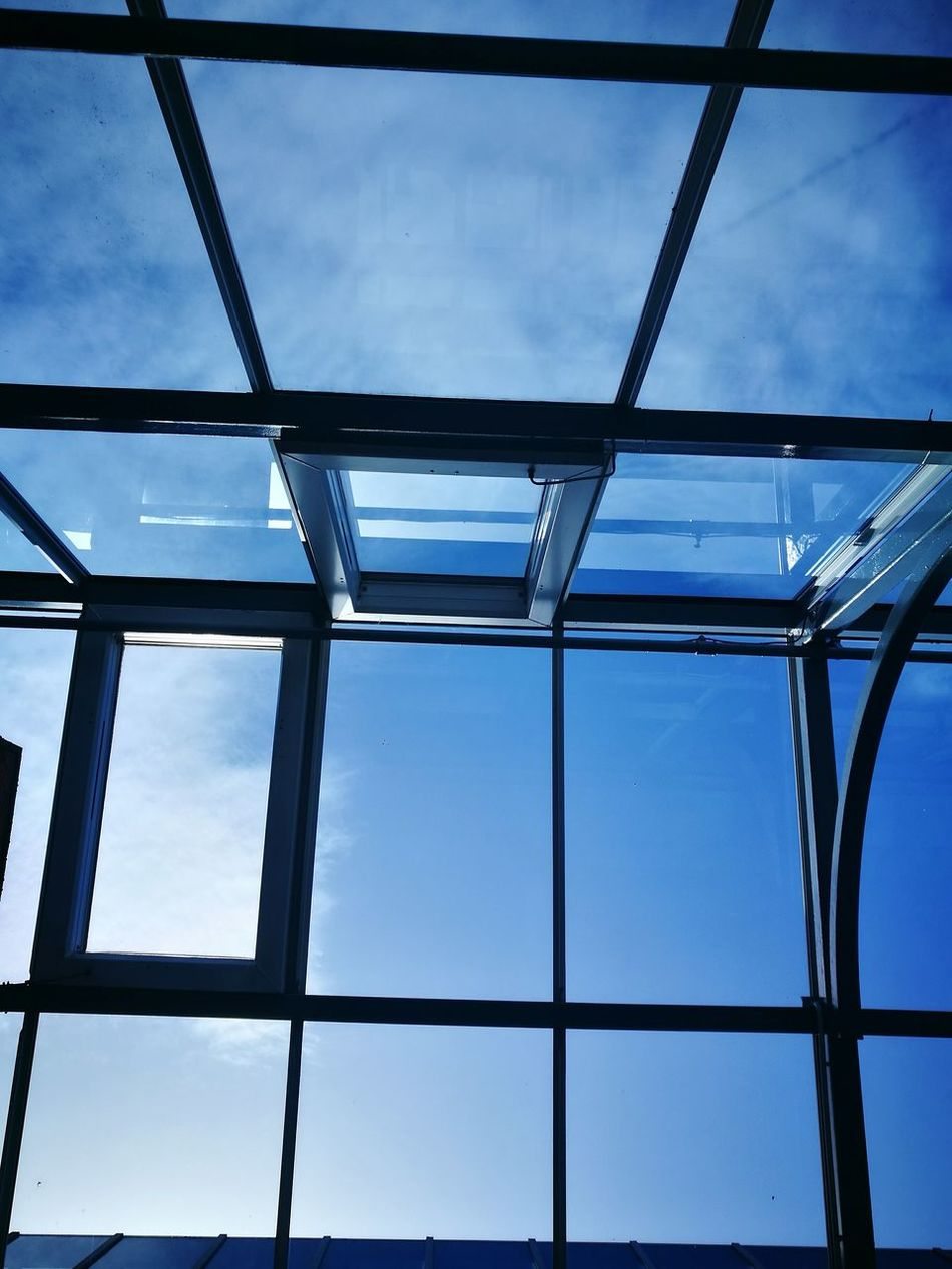 Low Angle View Architecture Indoors  Backgrounds Full Frame Built Structure Blue Ceiling Sky Geometric Shape Day Cloud - Sky Modern England In Autumn Cloudscape No People Atmospheric Mood High Section Man Made Structure Architecture Window Building Exterior Cloud And Sky Blue Sky Thinking Glass House
