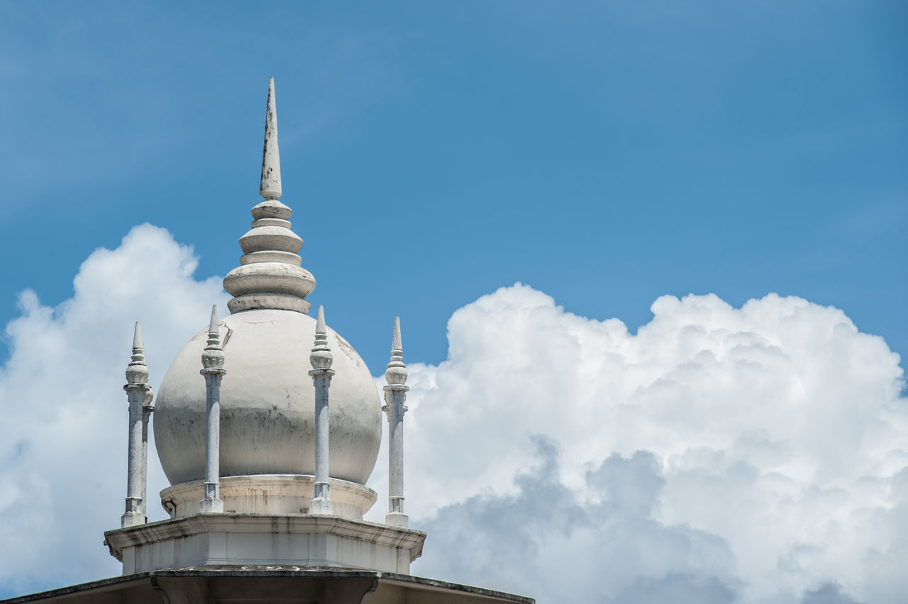High Section Of Mosque Against Cloudy Sky
