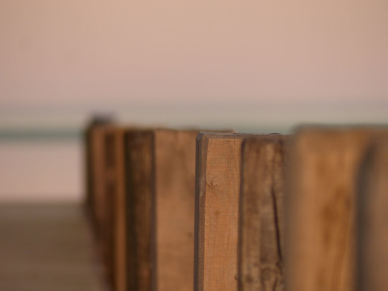 sea, selective focus, water, beach, wood - material, horizon over water, no people, close-up, nature, focus on foreground, outdoors, day, beauty in nature, sky