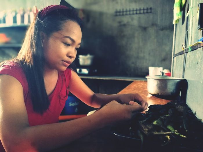 Preparation  Preparing Food Mid Adult Adult Indoors  Only Women People One Person Lifestyles Kitchen Adults Only Women Beauty Food Young Adult One Woman Only Human Hand Freshness Close-up Asian Culture Asianfood Asian Girl Asian Beauty Asian Cuisine Filipino Dish