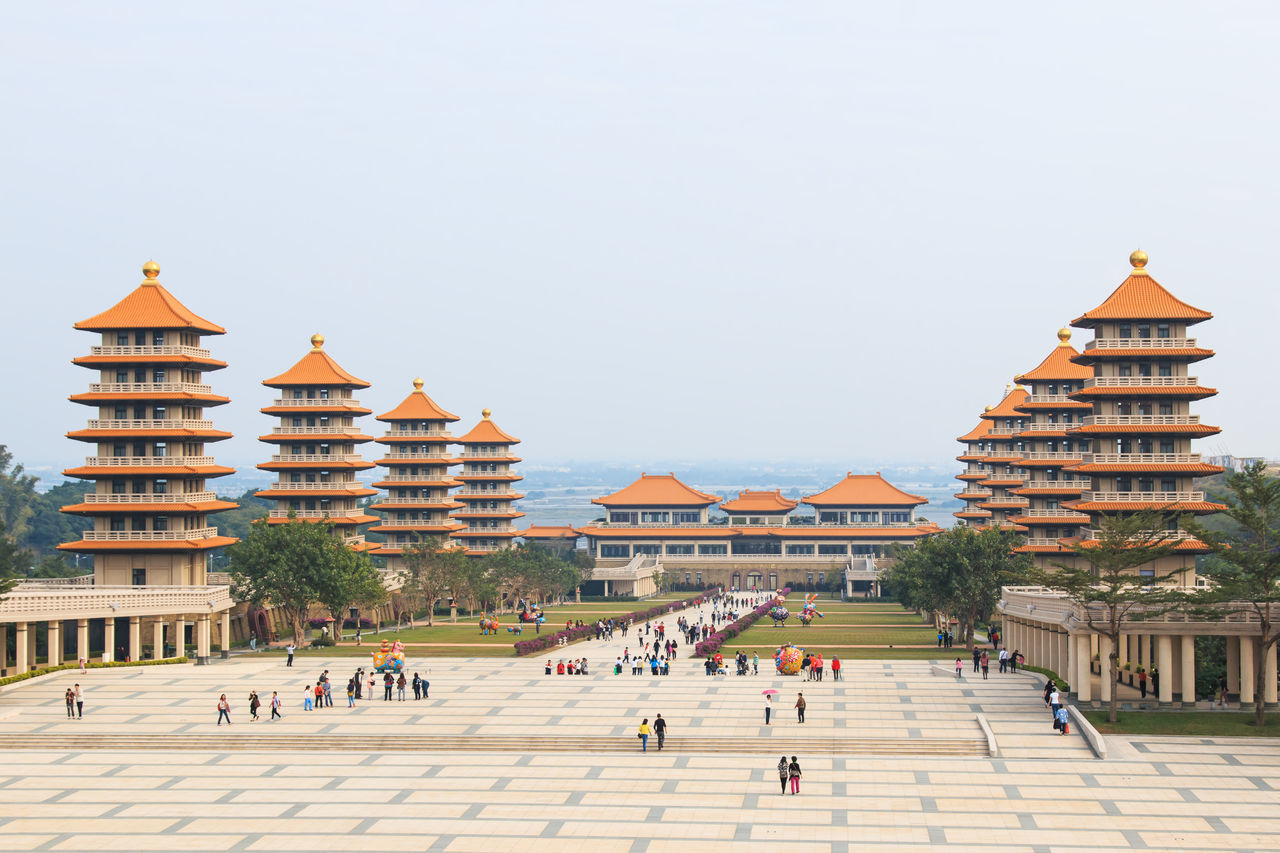 Kaohsiung, Taiwan - December 15, 2014: Sunset at Fo Guang Shan buddist temple of Kaohsiung, Taiwan with many tourists walking by. Architecture ASIA Asian Culture Buddhist Building Exterior Built Structure Capital Cities  China City City Life Clear Sky Culture Day Exterior Façade Famous Place Fo Guang Shan History Kaohsiung Orient Outdoors Sky Taiwan Tourism Travel Destinations