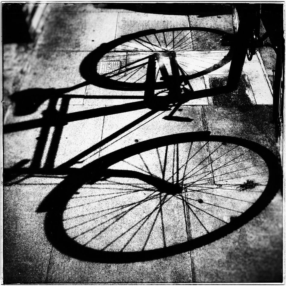 Shadow Cycle Shadow No People Deanstreetdesigns Monochrome Photography Filmnoirmood EE_Daily: Black And White Black And White Photography Blackandwhite Blackandwhitephotography Black And White Black & White Black And White Collection  Filmnoir Noir Et Blanc Monochrome Blackandwhite Photography Shadows And Silhouettes Mobile_photographer Mobile Phone Photography Snapseed PhonePhotography Phoneography Phone Photography