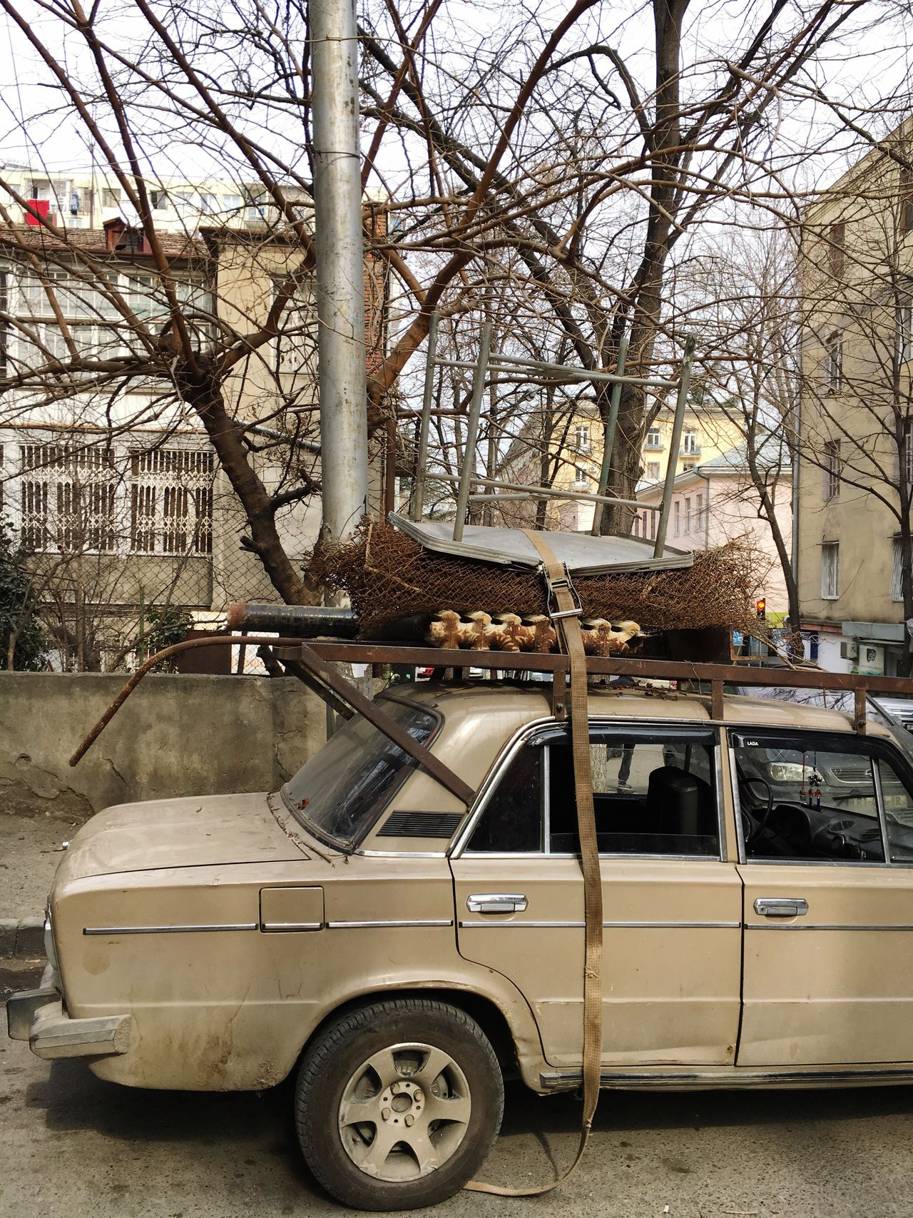 The mode of transport.. 😁🚘 Transportation Car Land Vehicle Mode Of Transport Stationary Outdoors No People City Tbilisi Old Car Junk Rusty Life In Tbilisi Shabby Moving Stuff Poor  Poor People  Brown