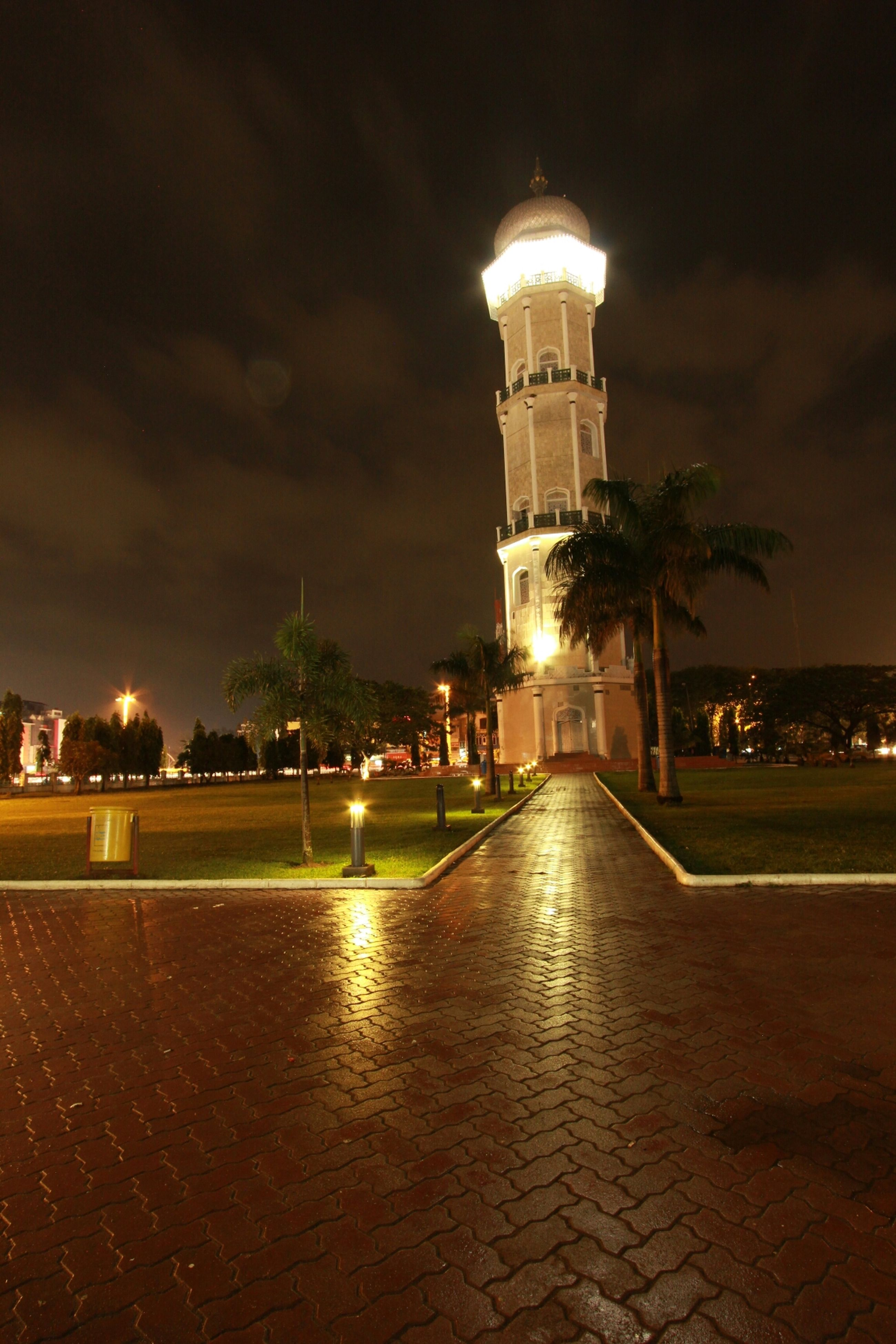 architecture, building exterior, built structure, sky, illuminated, night, tower, cloud - sky, street light, lighting equipment, city, the way forward, travel destinations, dusk, outdoors, street, footpath, famous place, cloudy, travel