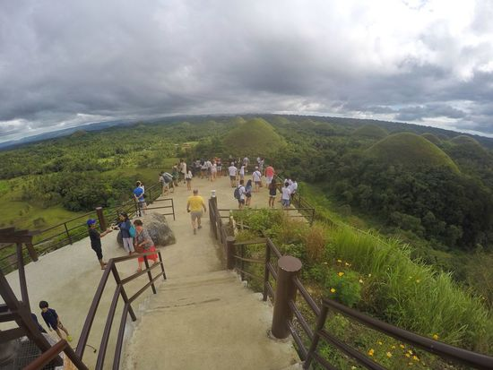Green Chocolate Kisses! Nature Dramatic Sky Large Group Of People Beauty In Nature Outdoors Cloud - Sky Vacations People Storm Cloud Day Adult Sky Crowd Bohol Philippines Chocolatehills