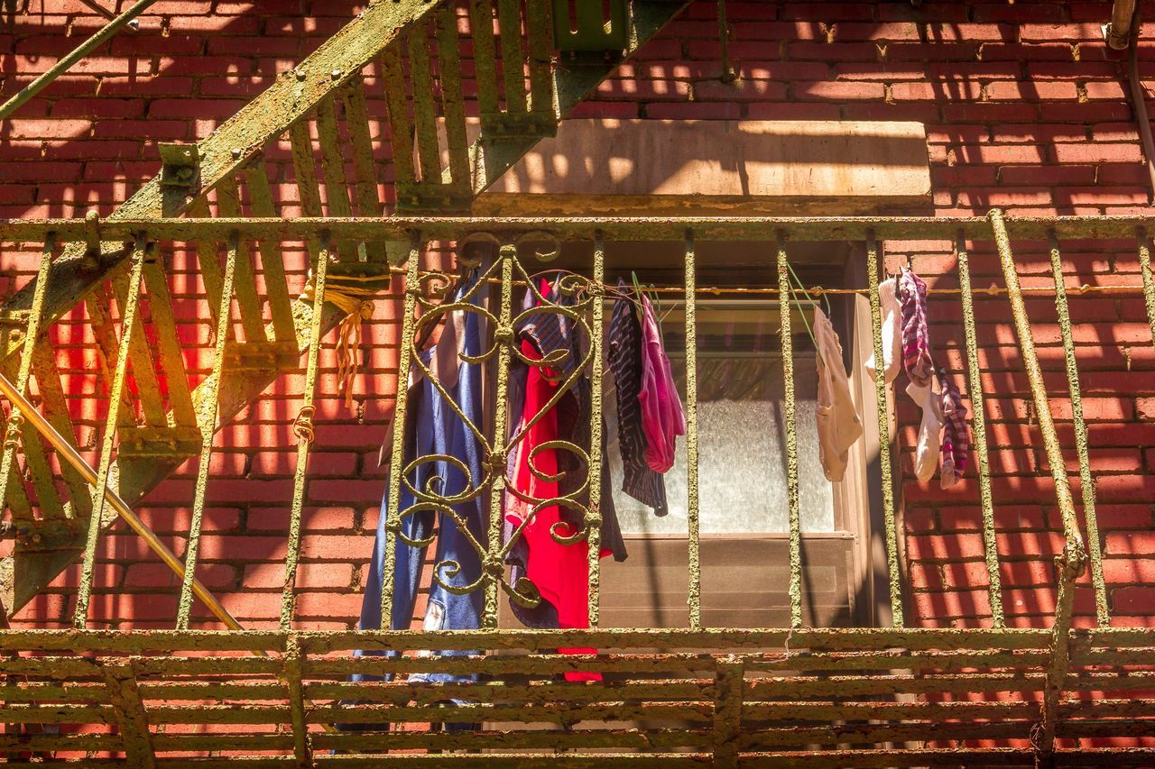 Laundry day Hanging Outdoors Built Structure Day No People Building Exterior Drying Coathanger Architecture Close-up Laundry Laundry Day Balcony Grid Ladyphotographerofthemonth City Life City Downtown District Close Up