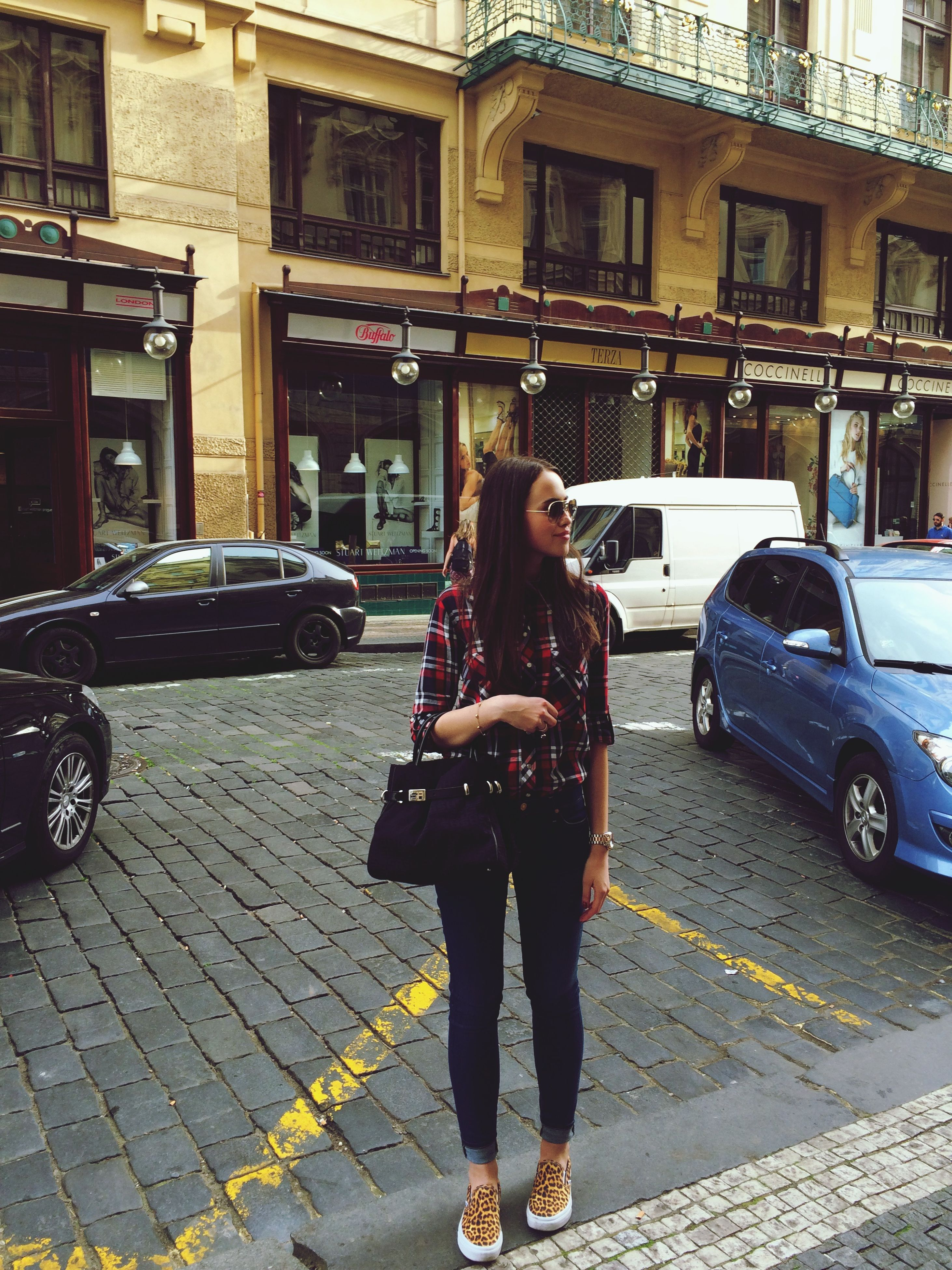 street, lifestyles, full length, casual clothing, building exterior, car, land vehicle, transportation, leisure activity, city, sidewalk, road, mode of transport, city life, architecture, built structure, rear view, city street