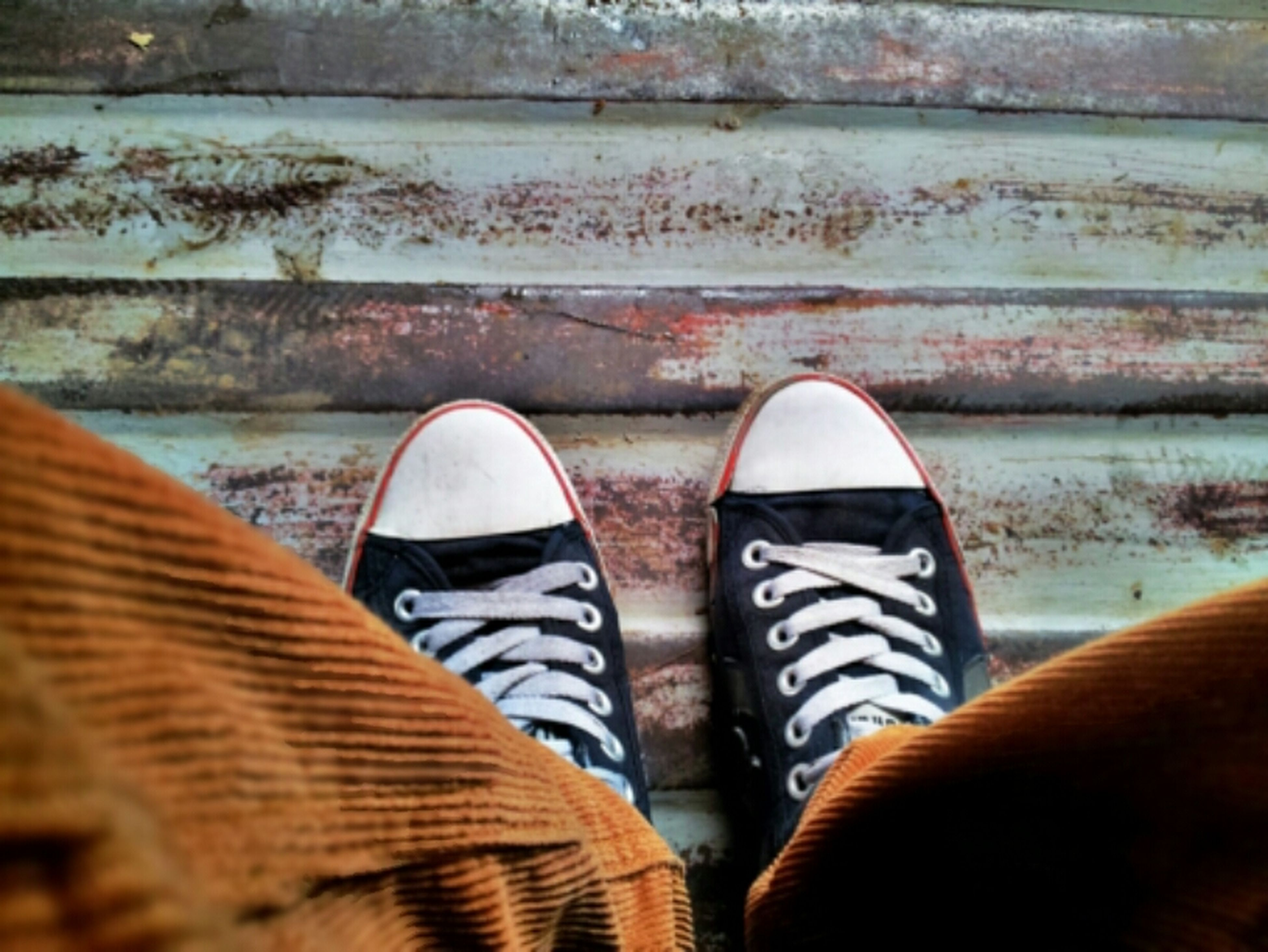 low section, shoe, person, personal perspective, standing, footwear, human foot, jeans, lifestyles, close-up, outdoors, men, day, striped, leisure activity, canvas shoe, pattern
