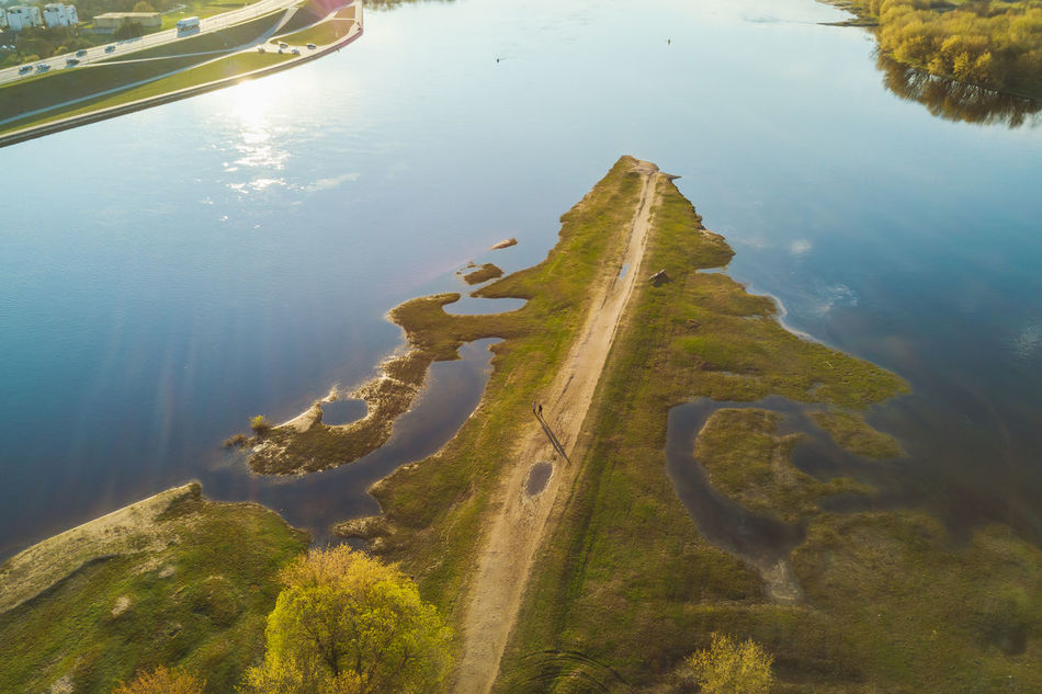 Confluence of two rivers (Nemunas and Neris), sunset time Beauty In Nature City Confluence Day Drone  Grass High Angle View Lake Mavic Mavic Pro Nature Outdoors People People Shadow Reflection Scenics Spring Sunset Tranquility Tree Water