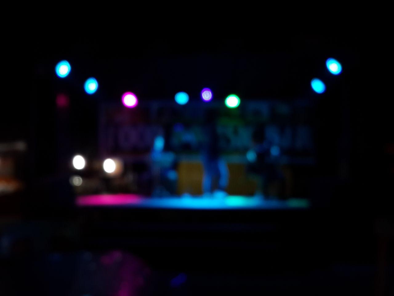 illuminated, night, lighting equipment, nightlife, large group of people, indoors, real people, stage light, nightclub, stage - performance space, audience, performance, defocused, disco lights, crowd, close-up, people