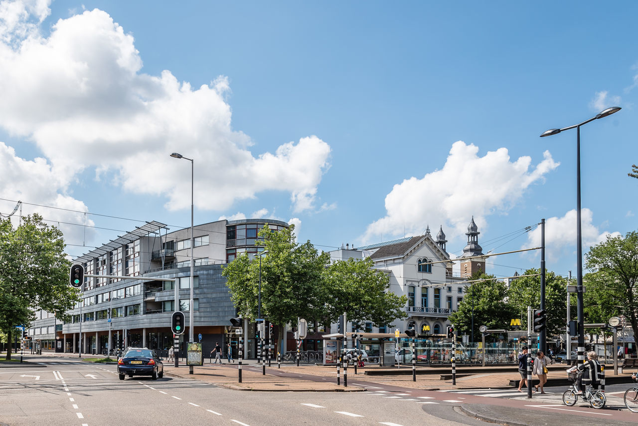 Cityscape of Rotterdam Architecture Building Exterior Built Structure City Cloud - Sky Crossroads Day Iconic Men Outdoors People Real People Sky Travel Travel Destinations Tree