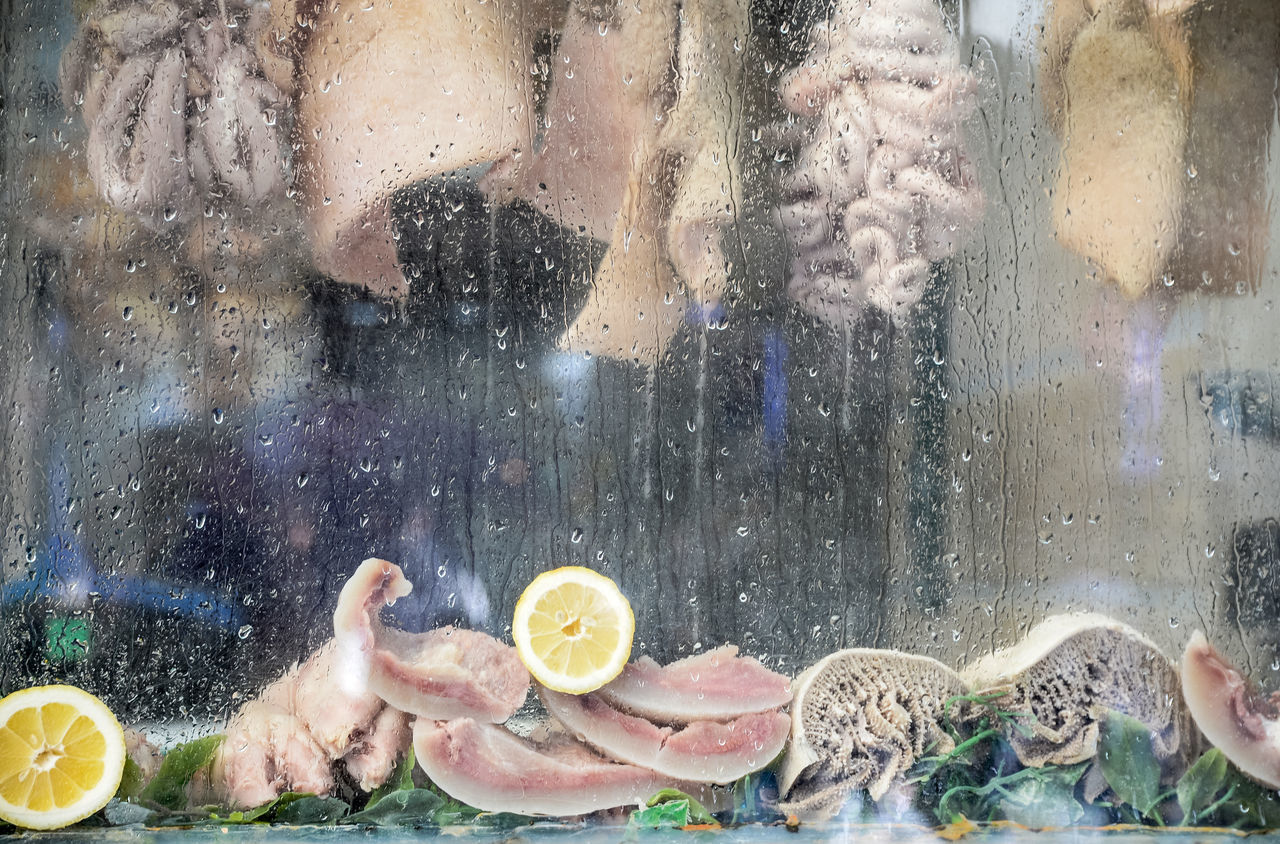 Meat At Store Seen Through Wet Glass