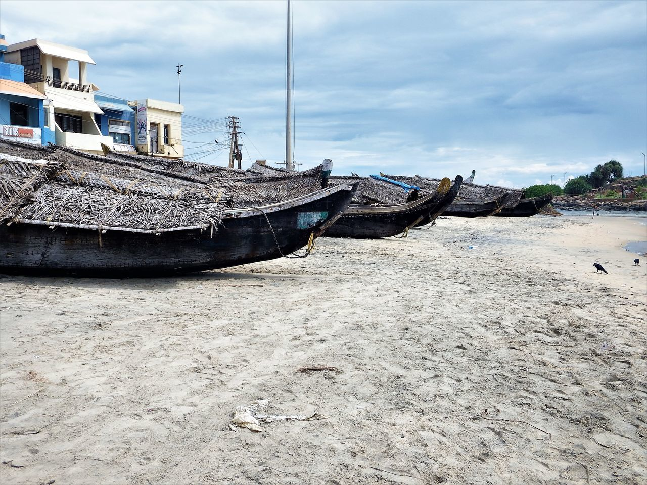 nautical vessel, moored, boat, sky, beach, cloud - sky, sand, mode of transport, no people, day, water, transportation, outdoors, sea, nature
