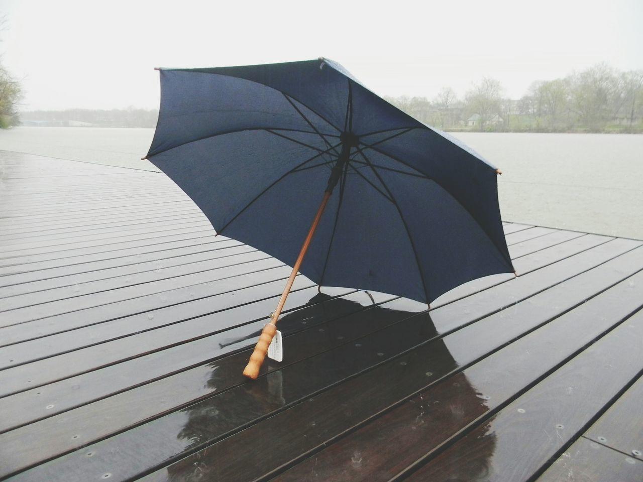 Rain Protection Wet Outdoors Water Unbrella Unbrellas Riverside EyeEm Best Shots Shadow Point Of View Marketing